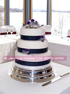 My cake will have my family tartan on it. It will be oval and have a white pattern put onto the white icing.