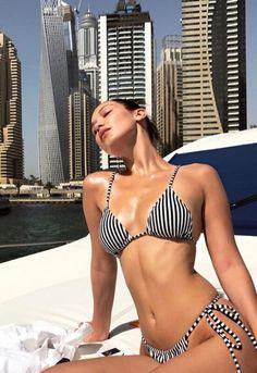 ♥️ Pinterest: DEBORAHPRAHA ♥️ Bella hadid wearing stripped black and white bikini in Dubai