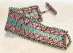 Please read this description as this is a different type of pattern for me.  This pattern for using the 2 hole Miyuki Tila Beads down the center of a peyote bracelet. It is a word chart mostly with the spacing to add the Tila down the center. The spacing of the Tila and associated instructions to pass through beads and when to pick up beads for the pattern at the Tila are included in the row by row instructions. There are NO DRAWINGS or step by step pictures in this. There is no bead graph…