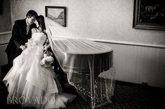 Bride and groom black & white wedding photo with piano   Brovado Weddings