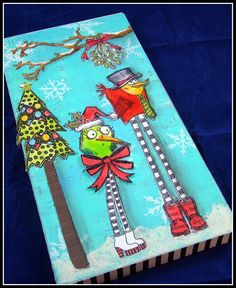You will love making this cute whack-a-doodle winter canvas using Tim Holtz's Bird Crazy and Dyan Reaveley Christmas stamps. So fun and clever!