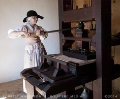 Reenactor demonstrating colonial style printing press, St. Mary's City, Maryland. Photo by Forrest Anderson. This and other photos by Forrest Anderson are available as fine art prints or digital versions at rouviere.com.