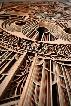 Oakland-based artist Gabriel Schama creates laser-cut wood relief wall art that feature layers of intricate swirls and abstract patterns. Myriads of geometric lines take the shape of human silhouettes, architectural elements, and mandala-like designs. Laser Art, 3d Laser, Laser Cut Wood, Laser Cutting, Wooden Wall Art, Wood Wall, Wood Sculpture, Sculptures, Gabriel