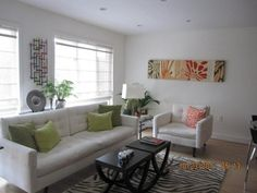 Anita Brown living room:  love the deep brown coffee table and sofa with green accent pillows