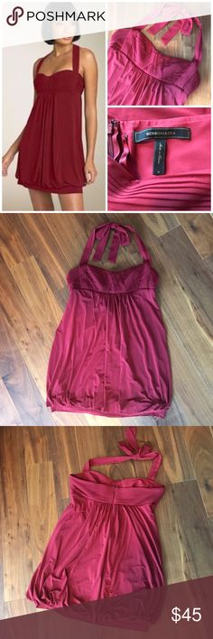 """BCBG MaxAzria Bubble Halter Dress, Ruby Red, M EXCELLENT Condition - worn only once to an event.   This BCBGMAXAZRIA mini dress shows off the legs while hiding the mid section. Fully lined with light padding at the pleated bust to eliminate """"high beams.""""  Empire waist and hidden back zip. The color is a ruby red / deep cranberry as depicted on the model in first photo -- my photos turned out brighter than actual dress.  Shell: 69% acetate, 23% nylon, 8% spandex. Lining: 84% polyester, 16%…"""