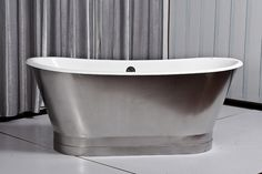 This 67 inch cast iron double ended stainless steel slipper pedestal tub is a beautiful addition to any bathroom. Stainless Steel Casting, Bathtub Doors, Pedestal Tub, Outdoor Tub, Tub Cover, Home Improvement Cast, Cast Iron Bathtub, Steel Bath, Modern Bathtub