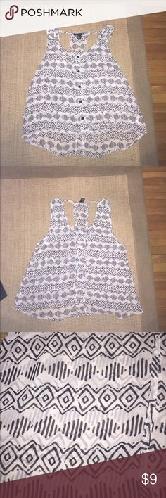 Aztec Black and White Cutout Tank Blouse Super stylish with a cut out back. Sometimes I would wear a colorful tank under. Forever 21 Tops Tank Tops
