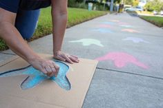 Make a sidewalk path to the Book Fair by drawing simple dinosaur footprints with