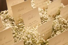 The escort cards will be tucked into baby's breathe like this.