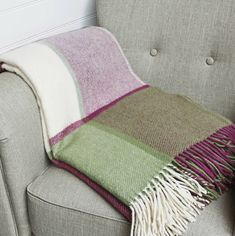 I've just found Raspberry Pink And Green Pure Wool Throw. Raspberry Pink & Green Wool Throw. £59.00