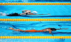 (Top to Bottom) Camille Muffat of France and Ranomi Kromowidjojo of the Netherlands compete during the Swimming Women's 100m Freestyle preliminaries heat seven on day thirteen of the 15th FINA World Championships at Palau Sant Jordi on August 1, 2013 in Barcelona, Spain.