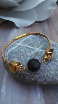 This bracelet is so stylish! Wear it on its own to make a statement. *To make it I have used beautiful natural cork. This is a fantastic material, it is very soft, supple and has a durable quality. *As a focal point there is a beautiful lava rock that has been wire wrapped to the strap. * Two g
