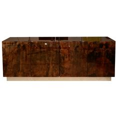 A Large Aldo Tura Lacquered Parchment Sideboard.