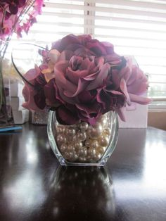 something simple for small tables -- pink and white flowers with pearls in the vase Glass Glass Burchard Design Clifford Gravitt Fake Flower Centerpieces, Pearl Centerpiece, Candle Centerpieces, Candles, Pearl Wedding Centerpieces, Fake Flowers Decor, Centrepieces, Centerpiece Ideas, Diy Flowers
