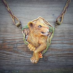 Pendant «Lioness», polymer clay on Behance