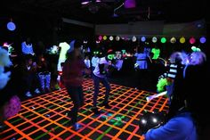 Blacklight Glow Party Dance floor made with neon duct tape.