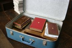 """""""'We had a final look around before leaving the house and in a cupboard in the Duchess's bedroom we found an old blue suitcase.' Dr Bell realised that this was what the Duchess had referred to as 'the holy of holies'. 'Opening the suitcase was an exciting moment: it contained some exceptionally rare first editions [...], a pristine first edition of Walt Whitman's 'Leaves of Grass', and some bizarre curiosities such as a fragment of Voltaire's dressing gown'. """" Trinity Library, Leaves Of Grass, Walt Whitman, Cupboard, Suitcase, Gown, Dressing, In This Moment, Wallet"""