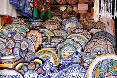 Talavera Pottery    Puebla, Mexico so cool to watch the 2 guys paint these by hand!