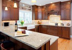 Modern kitchen design Giallo Ornamental granite countertops wood cabinetry