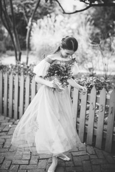 Rhys in a custom flower girl dress by Jill Andrews Gowns