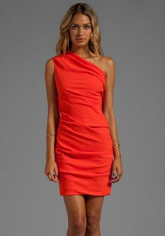 Love the bright color of this one shoulder cocktail dress. A pair of earrings and a bangle and you're set.