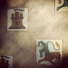 Castle and lion - tiles at the Alcazar, a fortress-palace with a Lion Gate.