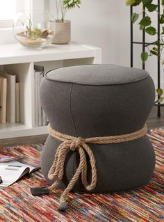 This item is only available for purchase online and home delivery.     A fun and stylish touch to add to your decor, perfect for the games room or children's bedroom, or to add additional seating in the living room or family room. A chic and rustic, nautical-style rope loops around the centre of the pouf and creates a lovely hourglass shape.      MATERIALS AND FINISH   Blend of felt-like polyester and natural rope      MAINTENANCE   Use a damp cloth with a mild fabric cleaner.  For toug...