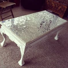Broken glass on acryllic painted vintage table.                                                                                                                                                     More