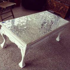 Broken glass on acryllic painted vintage table.