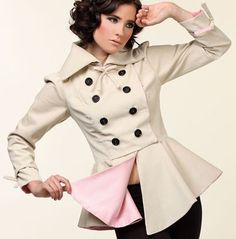 Double Breasted Corduroy Coat with Pink Lining and Black Buttons - I love this jacket!  The shape, the bows, the pink lining...  So cute!  This fashion designer has a great eye for fashion and clearly, pays attention to every little detail.  What talent!
