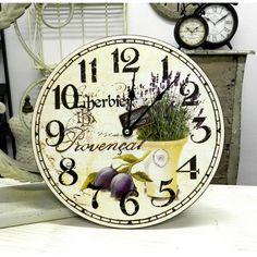 Okrągły zegar ścienny ze wzorem lawendy w żółtym wazonie podkreślającym prowansalski styl przedmiotu.