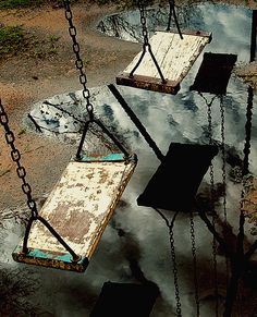 Rainy days, swings swaying in the breeze. like a rain dance.