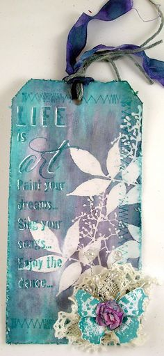 By Suzz. Resist with Distress Stains: broken china and concord grape. Leaf Sprig stamp by Stampendous.