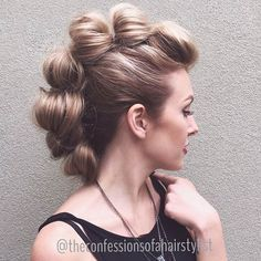 Looped faux hawk: pull hair through a half ponytail, then secure it with bobby pins. Repeat all the way down.