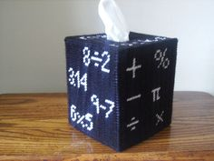 What a great way to encourage your kids that math rocks!!!! This is perfect for a math teacher to place in your classroom. On two sides of tissue cover you have six math symbols and the other two sides have some math problems.   I used: worsted weight acrylic yarn and plastic Canvas. Colors: White and Black