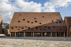 Kannikegården by Lundgaard & Tranberg Architects grows directly out of the local historical context of the Danish city of Ribe and at the same time enhances and adds new, exciting features to the medieval city center. Public Library Architecture, Wood Architecture, Brick Roof, Brick Facade, Brickwork, Cladding, Exterior, Building, Studio