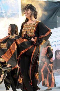 Palestinian girl in traditional thob dancing <3