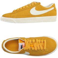 Nike Sneakers ($78) ❤ liked on Polyvore featuring shoes, sneakers, ocher, nike footwear, flat sneakers, nike trainers, leather trainers and nike shoes