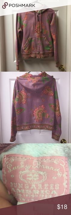 Women's Zipper Front Hoodie Women's/Junior's zippered front hoodie by Lucky Brand. It's a size large, but with all sweat jackets, it can be worn by a small or medium, also. It would just be a bit big. (I've worn it that way! 😊)  It has a lavender background with peach flowers. It's such a cute & cozy sweatshirt jacket. How perfect would this be with jeans & a pair of Converse All-Stars? Woo hoo! 🤗 Lucky Brand Tops Sweatshirts & Hoodies