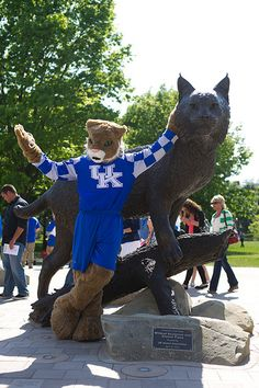 The Wildcat mascot poses with the newest campus landmark.