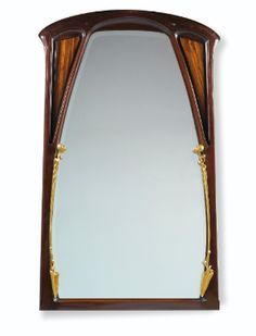 'AUX NÉNUPHARS', A MAHOGANY AND GILT BRONZE MIRROR BY LOUIS MAJORELLE, CIRCA 1900