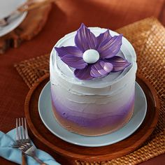 Looking for a minimalistic approach to cake decorating but still wanting a pop of color? Top your buttercream-iced cake with a fantasy flower, created from Decorator Preferred Purple Fondant and shaped using the Wilton Geometric Fondant Cut-Outs Pattern Set.