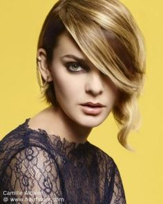 Blonde layered bob with long side bangs.