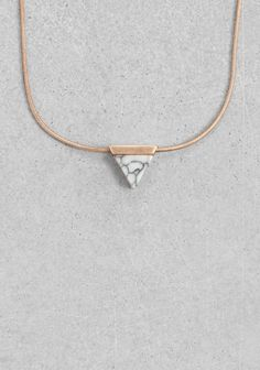 & OTHER STORIES A delicate snake chain necklace with a triangular pendant featuring a genuine marble-like stone.