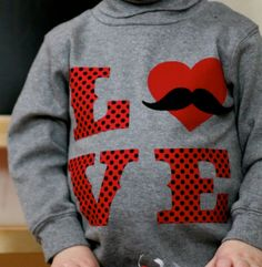 Valentine mustache heart shirt.  I cut fabric with transfer webbing on my Silhouette Cameo, and ironed onto shirt.