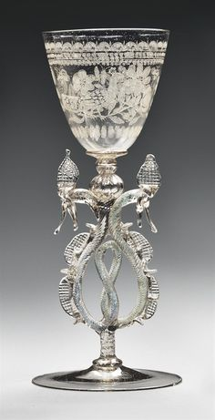 A FAÇON-DE-VENISE GLASS DIAMOND-POINT-ENGRAVED WINGED GOBLET -  THIRD QUARTER OF THE 17TH CENTURY, LOW COUNTRIES.