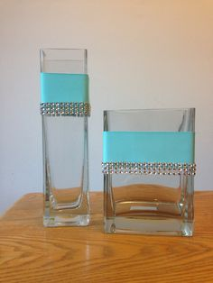 I crafted these Custom glass vase centerpieces  to match wedding or shower decor. Tiffany blue ribbon with rhinestone accent.