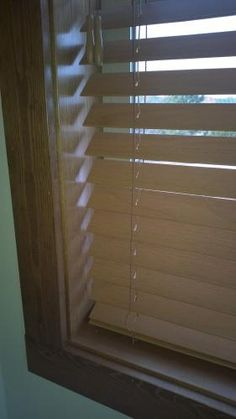 I have purchased these blinds to cover 17 windows for my home. They are of very good quality and reasonably priced. I have stained window trim on all these windows and the blinds blend beautifully with the trim. The bottom rail is weighted properly so that they hang well in the opening and do not 'flop' around like a sail in the wind. I am very pleased with this choice!