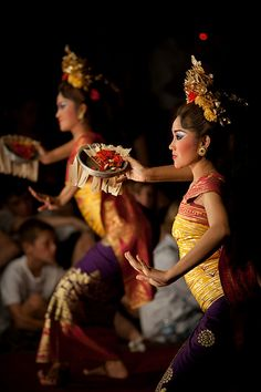 Pendet is a traditional dance from Bali, Indonesia, in which offerings are made to purify the temple or theater as a prelude to ceremonies or other dances. Pendet is typically performed by young girls, carrying bowls of flower petals, handfuls of which are cast into the air at various times in the dance. Pendet can be thought of as a dance of greeting, to welcome the audience and invite spirits to enjoy a performance.Pendet is the presentation of an offering in the form of a ritual dance.
