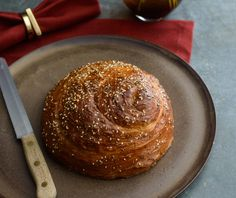 Sephardic Challah , uses raisins, eggs and full amount of honey to make a richer, festive Sephardic loaf. Seasoned with sesame, caraway and coriander, cumin, poppy seeds for a savory/sweet loaf.